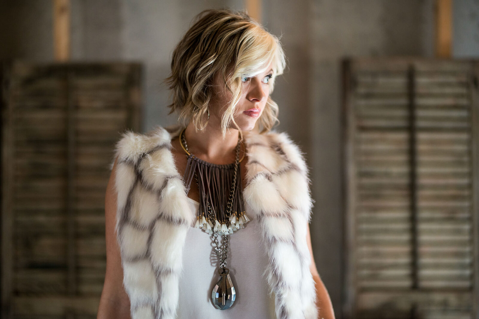 Fashion portrait of blond Atlanta actress in attic