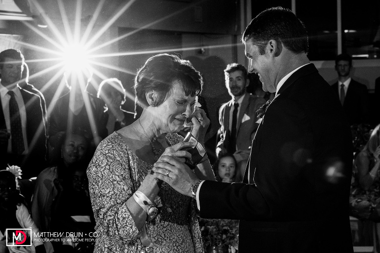Mom crying during first dance with son at Cator Woolford Gardens wedding reception