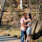 Engaged couple in Piedmont Park downtown Atlanta