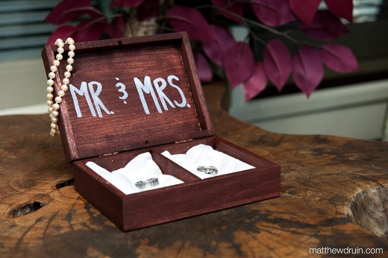 Bride & Groom rings in custom wood box with pearl necklace hanging off it at Chattooga Belle Farm South Carolina wedding