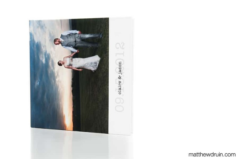 Signature Series wedding album cover standing on white seamless with reflection from Matthew Druin + Co. Photography