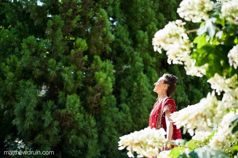 Indian bride relaxing in the sun in gardens at Atlanta wedding