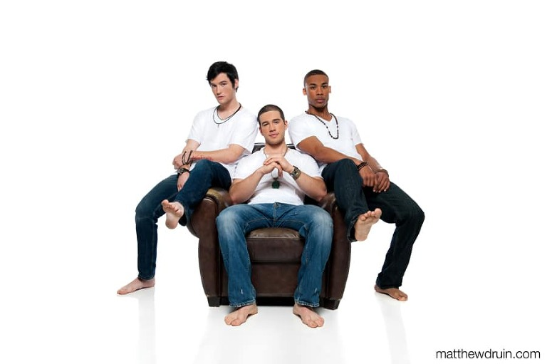 Atlanta music band The Years press and promo kit sitting on leather chair on white seamless
