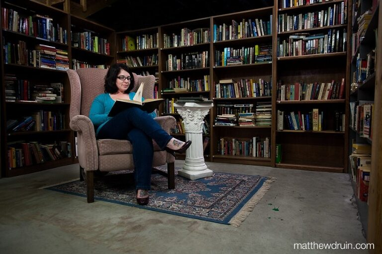 Meghan Stoneburner Atlanta Marketing expert sitting in pink chair wearing blue sweater Atlanta Vintage Books