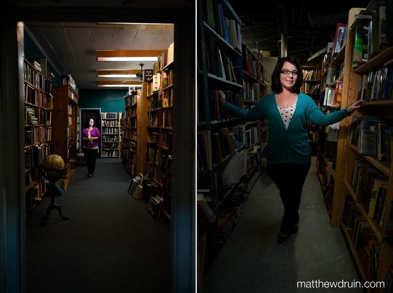 Meghan Stoneburner Atlanta SEO & Marketing expert standing in books with purple shirt at Atlanta Vintage Books