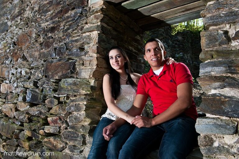 Engaged couple sitting at ruins at Soap Creek in Atlanta, GA