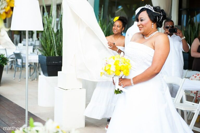 Bride Smiling With Yellow Rose Bouquet While Walking Dow Aisle At Puerto Rico Wedding Ceremony