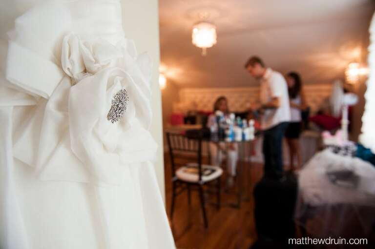 Atlanta bride getting ready on her wedding day with dress at Naylor Hall matthewdruin.com