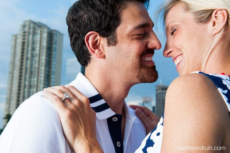 Engaged couple laughing in Midtown on downtown Atlanta, Georgia rooftop matthewdruin.com