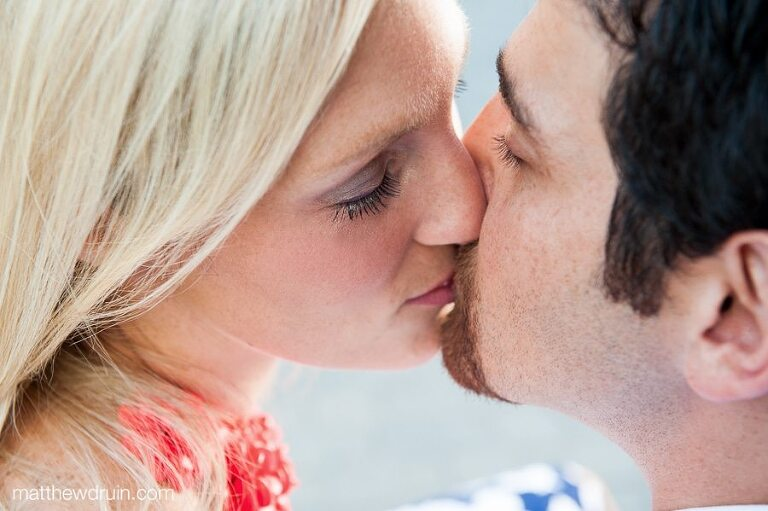 Close up shot of engaged couple kissing at Midtown Atlanta engagement