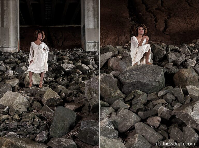 Editorial portraits of Atlanta wedding harpist Maya Lately wearing white dress and standing on large rocks under bridge