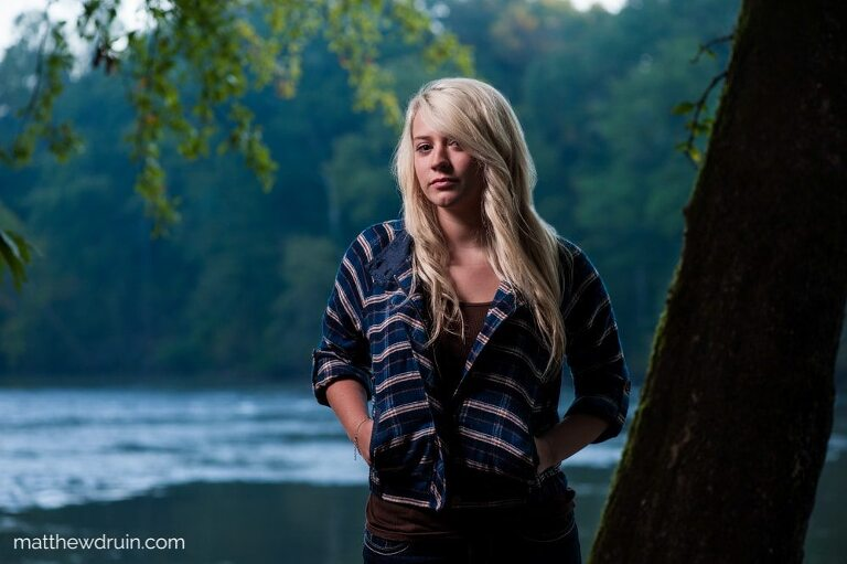 Blonde hair girl with hands in pockets in woods by Chattahoochee River for Atlanta sunrise portraits