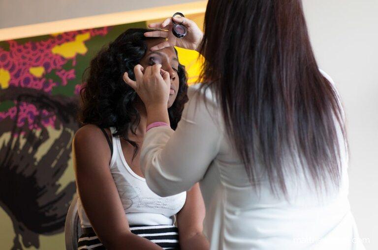 Makeup artist applying eyeshadow on bride getting ready for W Hotel Atlanta wedding
