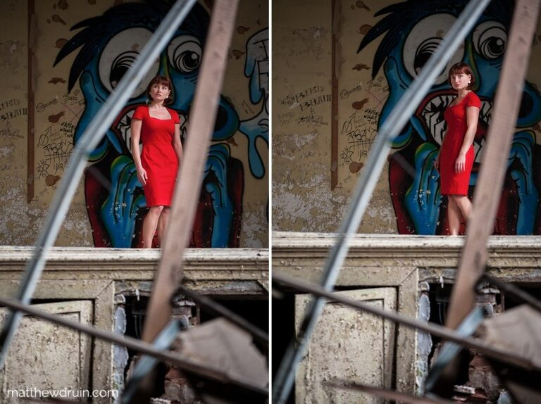 Red hair girl in red dress standing on theatre stage in abandoned Atlanta school