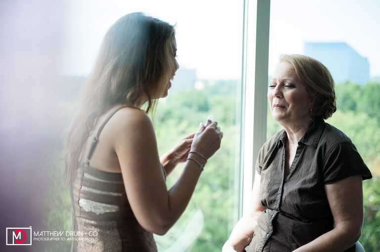 Brides mom getting makeup done for wedding at Le Meridian from Atlanta Wedding Photographers Matthew Druin + Co Photography.