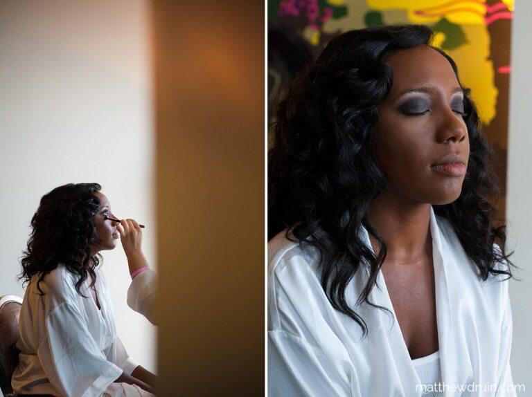 Bride with eyes closed getting eyeshadow getting ready for W Hotel Atlanta wedding