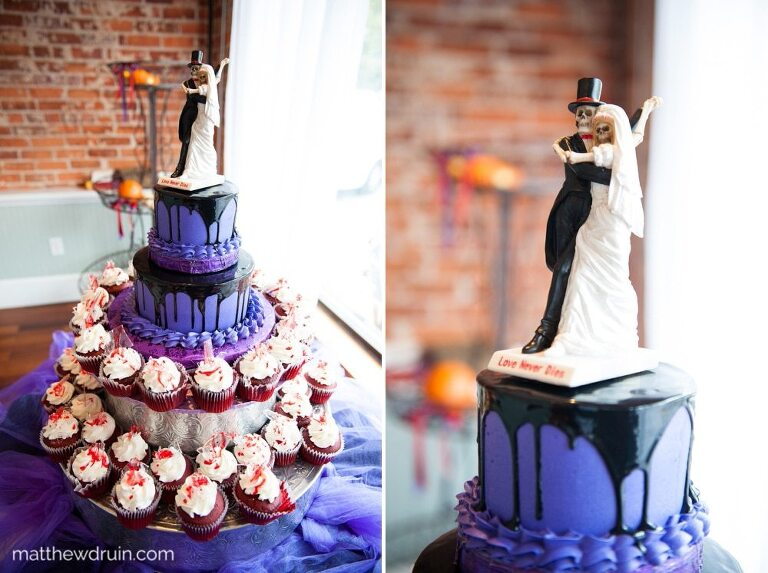 Bride and groom horror purple wedding cake with red blood cupcakes at halloween wedding at The Conservatory in Acworth