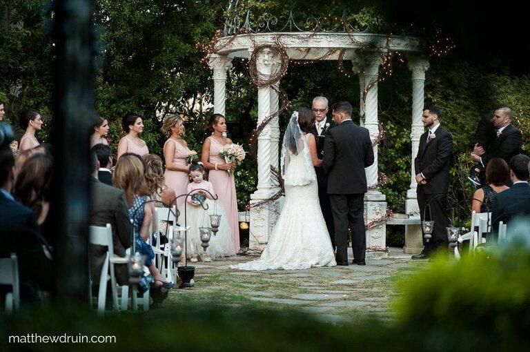 Bride and groom in garden ceremony at Atlanta Wedding Venue The Atrium In Norcross Review
