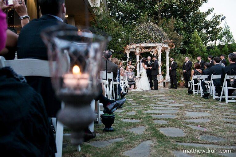 Bride and groom in garden ceremony with candles at Atlanta Wedding Venue The Atrium In Norcross