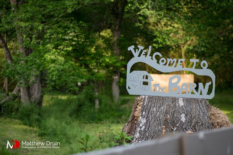 Welcome to the barn sign at romantic sunset engagement