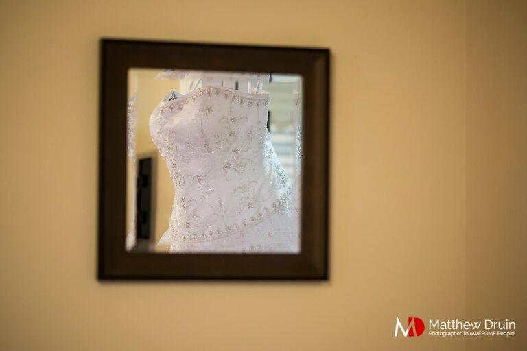 Reflection of bride's wedding dress in square mirror at Bride getting ready at destination wedding savannah Georgia
