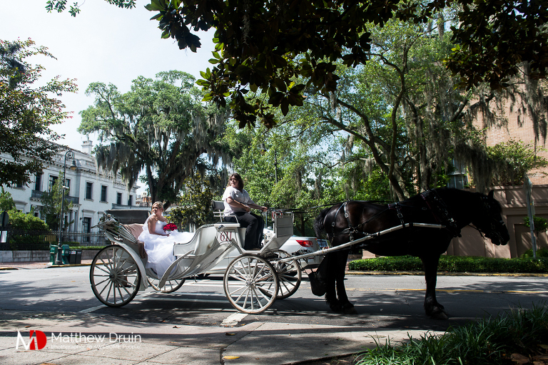Bride in horse drawn carriage for Forsyth Park wedding