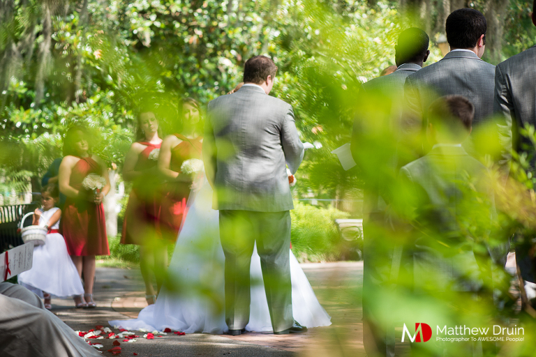 Bride and groom standing at alter Forsyth Park wedding ceremony