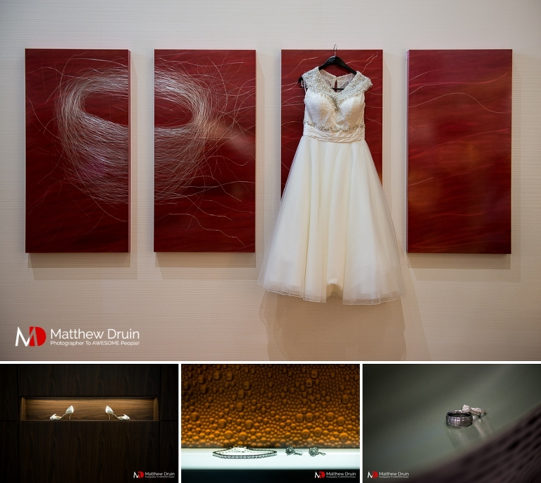 Bride's wedding dress hanging on artwork for Dekalb Courthouse wedding