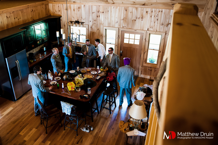 Guys getting ready in cabin at Chattooga Belle Farm wedding