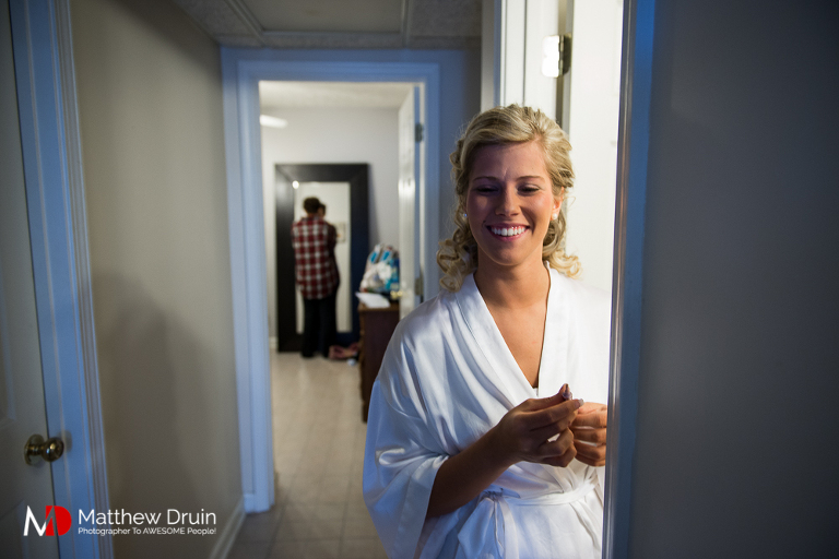Bride laughing while getting ready at country Georgia wedding in Woodstock