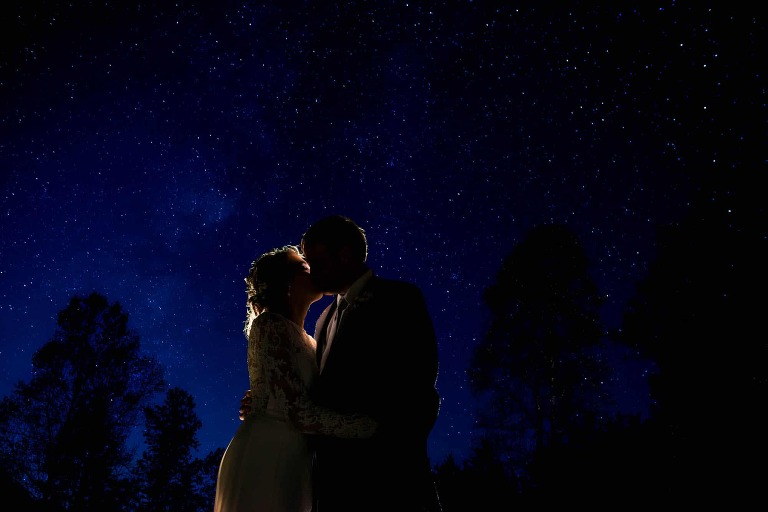 Bride and groom with starry skies at Neverland Farms