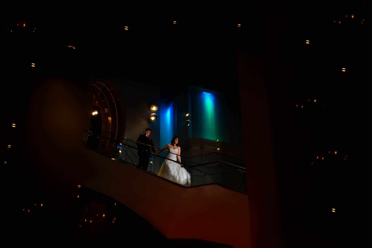 Bride and groom running down stairs at W Hotel