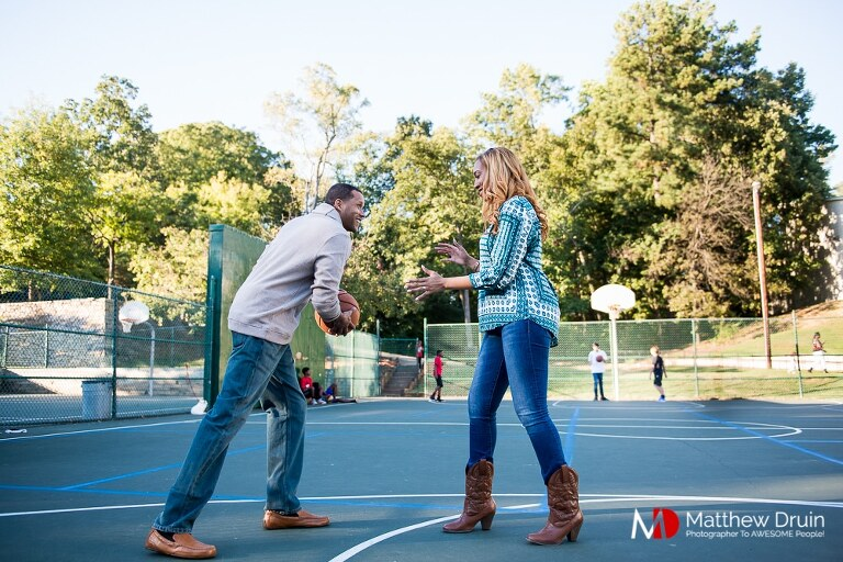 Engaged couple playing basketball at Basketball Themed Atlanta Engagement Session