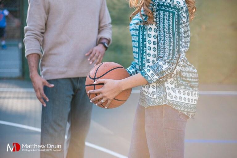 Girl holding basketball at Basketball Themed Atlanta Engagement Session