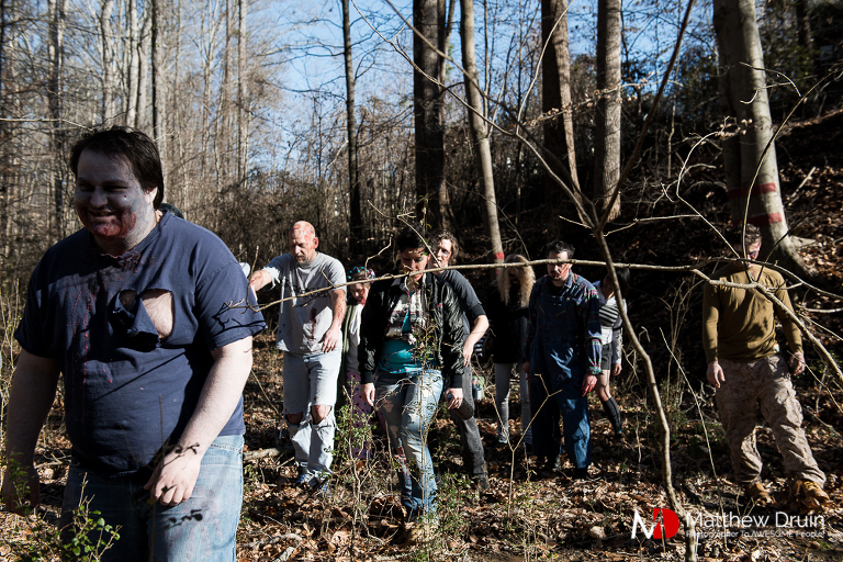 Zombies chasing engaged couple in Atlanta woods for the Walking Dead engagement session