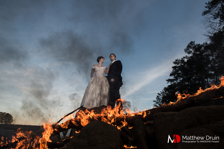 A winter trash the dress with fire session in the middle of Atlanta lake from Atlanta wedding photographers Matthew Druin & Co.