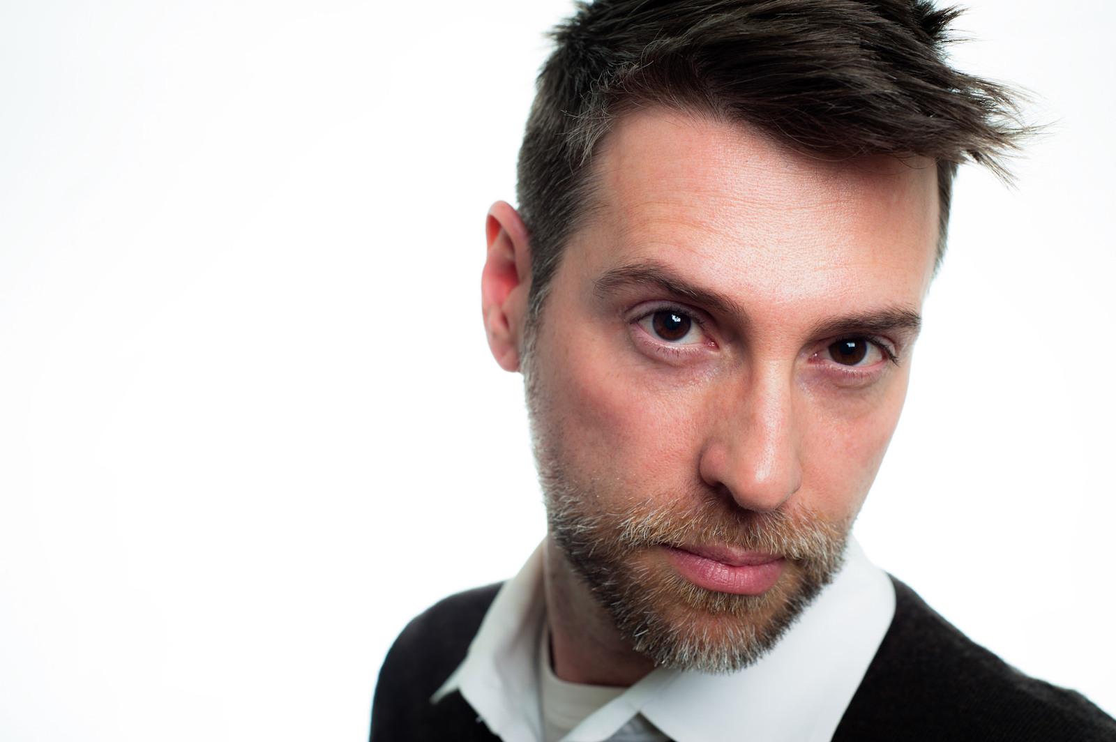 Atlanta actor headshot of James wearing black shirt on white seamless