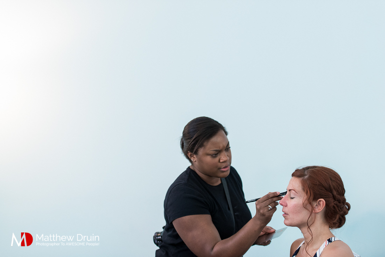 Bride getting makeup at warehouse wedding Venue 92 in Atlanta from Atlanta wedding photographers Matthew Druin & Co.