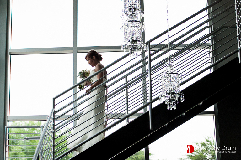 Bride walking to first look at Venue 92 from Woodstock wedding photographers Matthew Druin & Co.