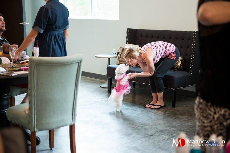 Bridesmaid playing with dog at Atlanta wedding at Venue 92 from Atlanta wedding photographers Matthew Druin & Co.