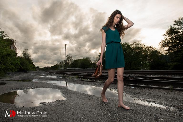 Girl carrying Louis Vuitton heels in urban Atlanta for fashion editorial from Atlanta portrait photographer Matt Druin.