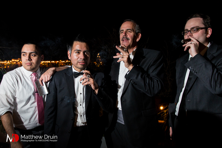 Groom and groomsmen smoking cigars at Neverland Farms wedding from Georgia wedding photographers