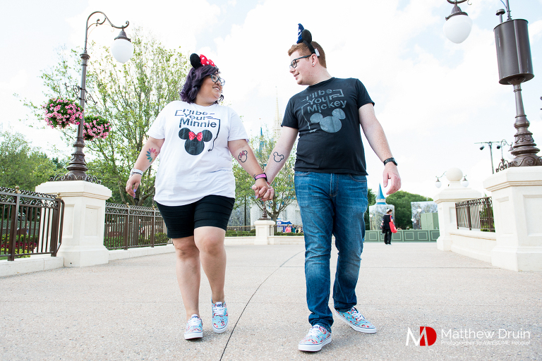 Couple holding hands and walking at Walt Disney World engagement session