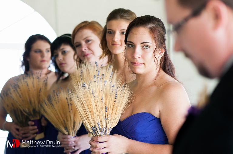 Maid of honor watching bride at ceremony at Atlanta wedding from Atlanta wedding photographers Matthew Druin + Co