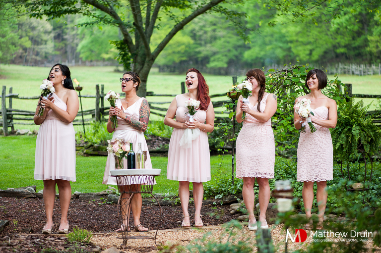 Bridesmaids cheering bride at North Georgia wedding from Atlanta wedding photographers Matthew Druin + Co
