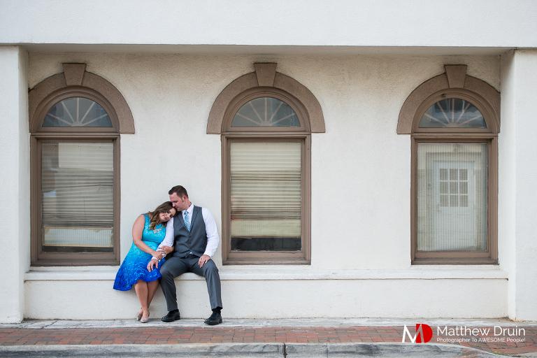 Engaged couple in Marietta square cuddling at Atlanta engagement session from Atlanta wedding photographers Matthew Druin + Co.