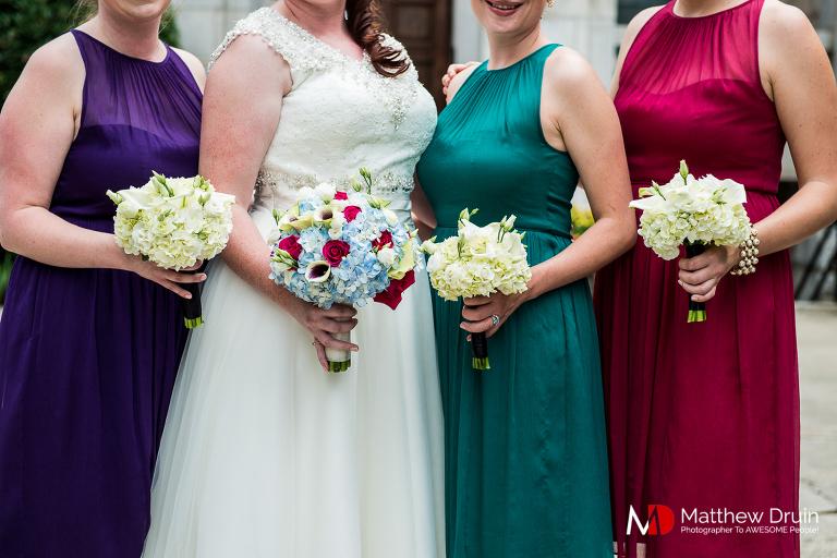Bridesmaids with different color bridesmaids dresses at Atlanta wedding from Atlanta wedding photographers Matthew Druin & Co