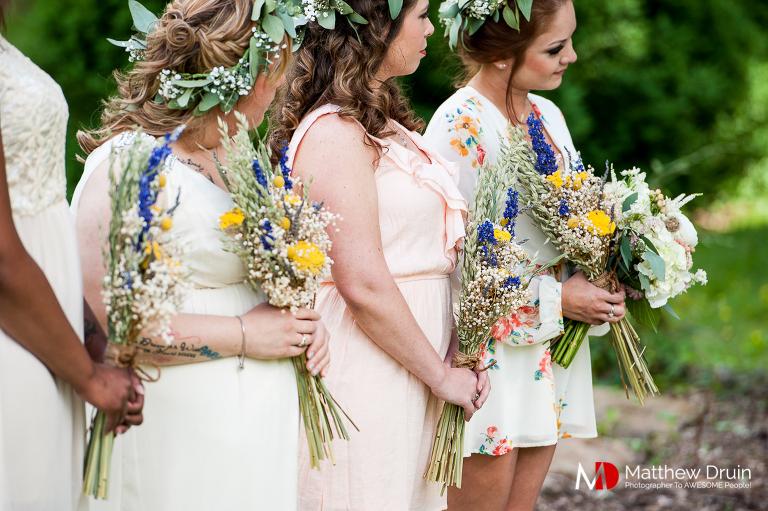 Bridesmaids watching bride at ceremony at North Carolina wedding from Atlanta wedding photographers Matthew Druin + Co