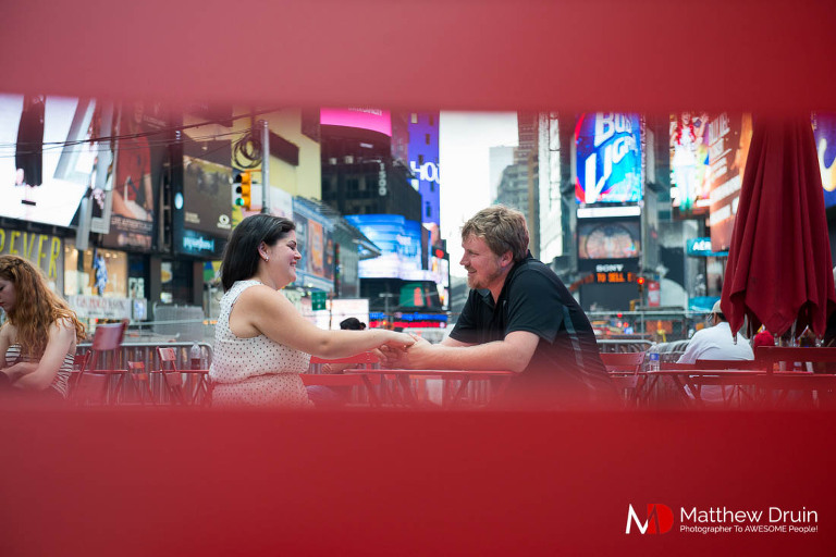 Engaged couple in Times Square in New York City engagement session from Atlanta wedding and portrait photographer Matt Druin.