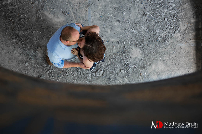 Couple kissing through tunnel at destination Florida engagement session in Jacksonville from Atlanta wedding photographers Matthew Druin + Co.